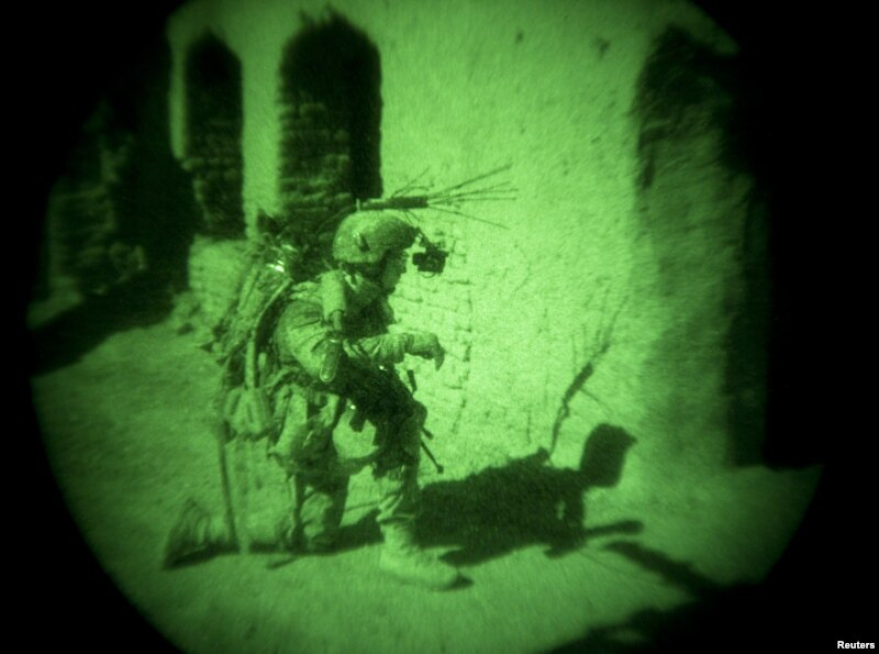 A coalition soldier in Afghanistan is seen through a night vision device.