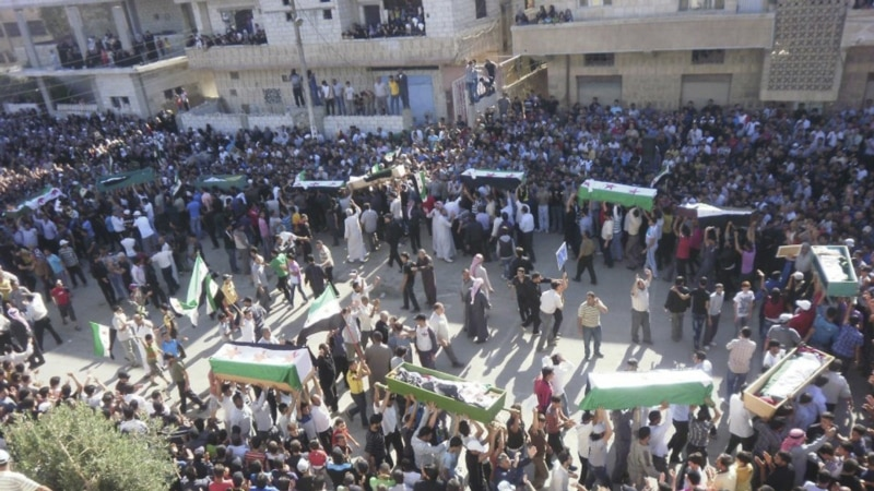 Activists: Syrian Troops Kill 52 Civilians in Saturday Attacks