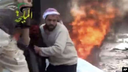 This video provided by Shaam News Network, which has been authenticated, shows a wounded man being pulled from the site of a Syrian government airstrike on a gas station in the eastern Damascus suburb of Mleiha, Syria, Jan. 2, 2013.