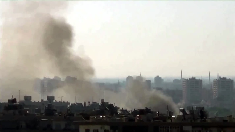 Activists: Syrian Helicopters Strike Damascus
