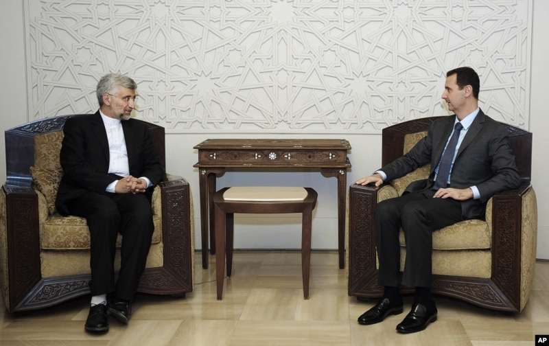 In this photo Iran's Supreme National Security Council, Saeed Jalili, meets with Syrian President Bashar Assad in Damascus, Syria, Tuesday, Aug. 7, 2012