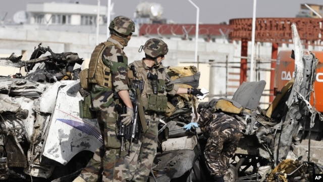 French soldiers arrive at the scene of a suicide bombing, September 18, 2012 in Kabul, Afghanistan.